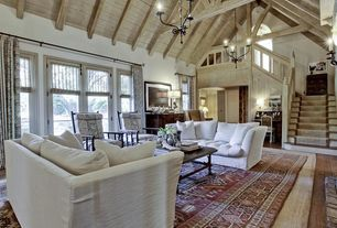 Traditional Living Room with picture window, Chandelier, Exposed beam, High ceiling, Hardwood floors