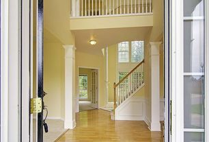 Traditional Entryway with Balcony, Columns, Hardwood floors, flush light, High ceiling, French doors