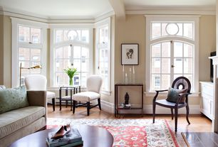 Traditional Living Room with Standard height, Crown molding, specialty window, Hardwood floors, Exposed beam