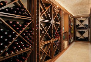 Traditional Wine Cellar with limestone tile floors, Crown molding