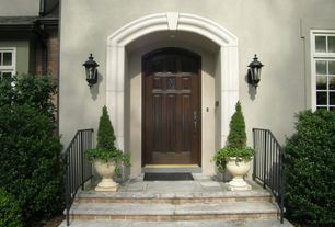 Traditional Front Door with exterior tile floors, exterior concrete tile floors, Raised beds