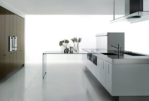Contemporary Kitchen with Flush, Concrete tile , Standard height, wall oven, European Cabinets, electric cooktop, Island Hood