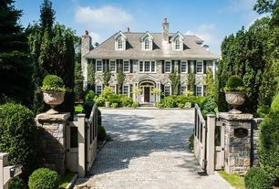 Traditional Exterior of Home with Colonial style home, Gate, Fence, Arched window, Pathway, Interlocking paver driveway