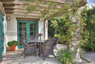 Traditional Patio with exterior stone floors, Trellis, Pathway, French doors