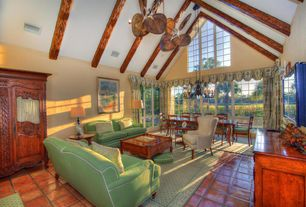 Tropical Living Room with terracotta tile floors, Ceiling fan, High ceiling, Exposed beam