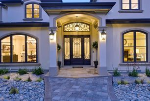 Mediterranean Front Door with Transom window, Arched window, exterior stone floors, Glass panel door, Pathway