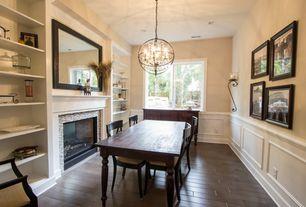Traditional Dining Room with Wainscotting, Crown molding, Built-in bookshelf, Hardwood floors, Pendant light
