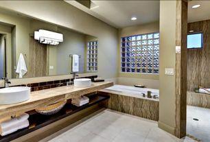 Contemporary Master Bathroom with limestone tile floors, Kohler Vox Round Above Counter Bathroom Sink in White, Vessel sink