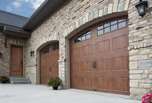 Rustic Garage with Wall sconce, Barn door, Concrete floors, High ceiling, six panel door