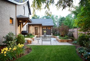 Traditional Patio with Fence, exterior stone floors, Outdoor kitchen