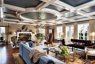 Eclectic Living Room with Area rug, Chandelier, stone fireplace, Crown molding, Box ceiling, Area, French doors