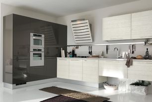 Contemporary Kitchen with Corian counters, European Cabinets, Undermount sink, Flush, L-shaped