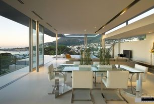 Contemporary Dining Room with Concrete tile , Seven Glass Table, Cramco Spica Breuer Side Chair