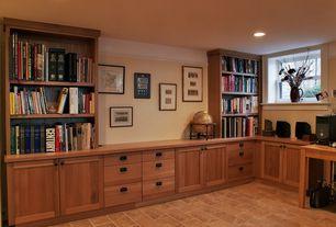 Craftsman Home Office with Built-in bookshelf, Alder recessed panel cabinets, Porcelain tile floor, Paint