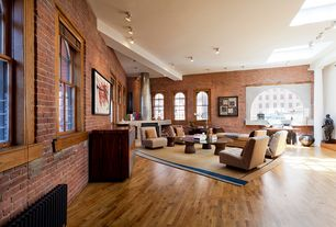 Contemporary Living Room with Chandelier, Hardwood floors, Arched window, Built-in bookshelf, Exposed beam, Columns