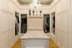 Traditional Closet with Stone source, crema marfil, marble, beige/taupe, Hardwood floors, Standard height, Chandelier