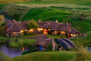 Eclectic Exterior of Home with Hobbiton Movie Set The Green Dragon Inn, Thomas Studio Arched Antique Wood Door, Fence, Pond