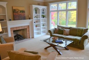 Contemporary Living Room with Standard height, Built-in bookshelf, brick fireplace, Casement, Paint, Carpet, Fireplace