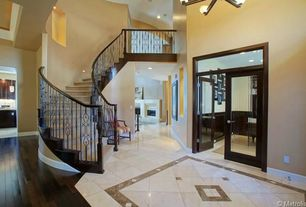 Traditional Staircase with curved staircase, Carpet, Balcony, High ceiling, can lights
