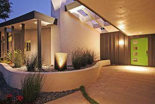 Modern Front Door with exterior stone floors, Skylight, Raised beds, Glass panel door