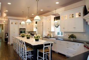 Traditional Kitchen with Stone Tile, Granite countertop in absolute black, Pendant light, can lights, Crown molding, Casement