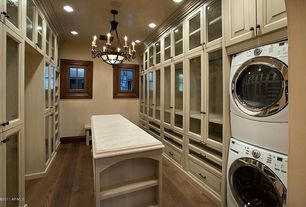 Traditional Closet with Custom Cabinetry, Exquisite Antique Five-Light Chandelier with Original Shade, Hardwood floors