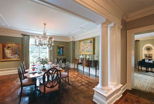 Traditional Dining Room with French doors, Transom window, interior wallpaper, Chandelier, Hardwood floors, Crown molding