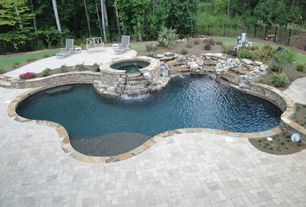 Traditional Swimming Pool with Fence, Raised beds, Pool with hot tub, exterior stone floors