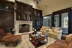 Traditional Living Room with High ceiling, picture window, Cement fireplace, can lights, Fireplace, French doors, Chandelier