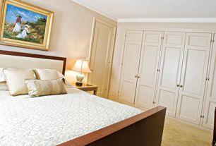 Traditional Master Bedroom with six panel door, Built-in bookshelf, Carpet, Standard height, Crown molding