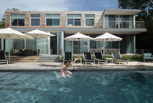 Contemporary Swimming Pool with Fence, exterior tile floors, French doors