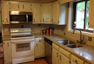 Rustic Kitchen with Stone Tile, Raised panel, L-shaped, Simple granite counters, Inset cabinets, Hardwood floors