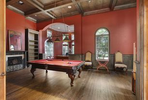 Traditional Game Room with Pendant light, stone fireplace, Arched window, Built-in bookshelf, Wainscotting, Box ceiling