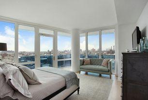 Contemporary Master Bedroom with Transom window, Columns, Safavieh Sarah Tufted Settee, French doors, Hardwood floors