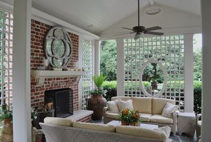 Traditional Porch with South Sea Rattan Del Ray Sofa with Cushions, exterior stone floors, Screened porch, Ceiling fan