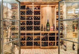 Rustic Wine Cellar with Brick floors, French doors, Built-in bookshelf