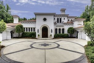 Mediterranean Exterior of Home with exterior tile floors, exterior concrete tile floors, picture window, Arched window