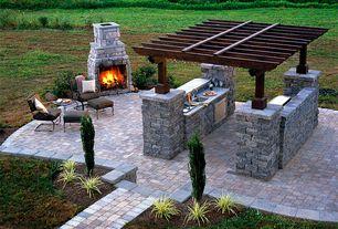 Rustic Patio with Outdoor kitchen, outdoor pizza oven, Pathway, exterior stone floors, Trellis