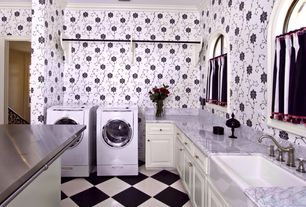 Traditional Laundry Room with interior wallpaper, Built-in bookshelf, Farmhouse sink, Crown molding, Concrete floors