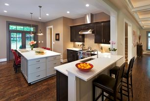 Contemporary Kitchen with Corian counters, Breakfast nook, Pendant light, L-shaped, Undermount sink, European Cabinets