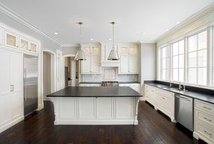 Traditional Kitchen with Subway Tile, DuPont Corian Deep Nocturne, U-shaped, Inset cabinets, Crown molding, Glass panel