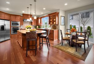 Traditional Kitchen with Stone Tile, Simple granite counters, Breakfast nook, Pendant light, Kitchen island, Glass panel