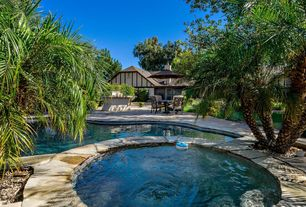 Tropical Swimming Pool with French doors, outdoor pizza oven, Pool with hot tub, exterior stone floors, Fence, Pathway