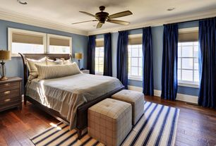 Traditional Master Bedroom with can lights, Standard height, Crown molding, Hardwood floors, Built-in bookshelf, Ceiling fan