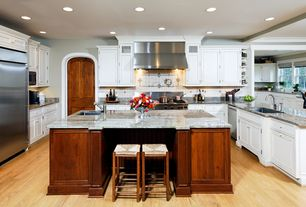 Traditional Kitchen with Undermount sink, specialty door, Standard height, U-shaped, Breakfast bar, Flat panel cabinets