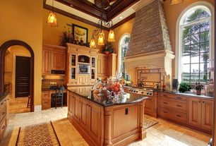 Traditional Kitchen with Limestone Tile, Quartz counters, High ceiling, Arched window, Raised panel, Kitchen island, U-shaped