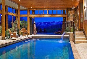 Rustic Swimming Pool with Indoor pool, Transom window, Pathway, French doors, Fountain, exterior stone floors