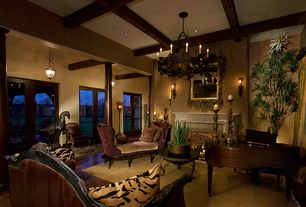 Traditional Living Room with Chandelier, French doors, Exposed beam, Pendant light, can lights, Standard height, Wall sconce