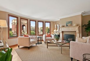 Traditional Living Room with Cement fireplace, Hardwood floors, Crown molding