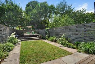 Modern Landscape/Yard with Pathway, Fence, exterior stone floors